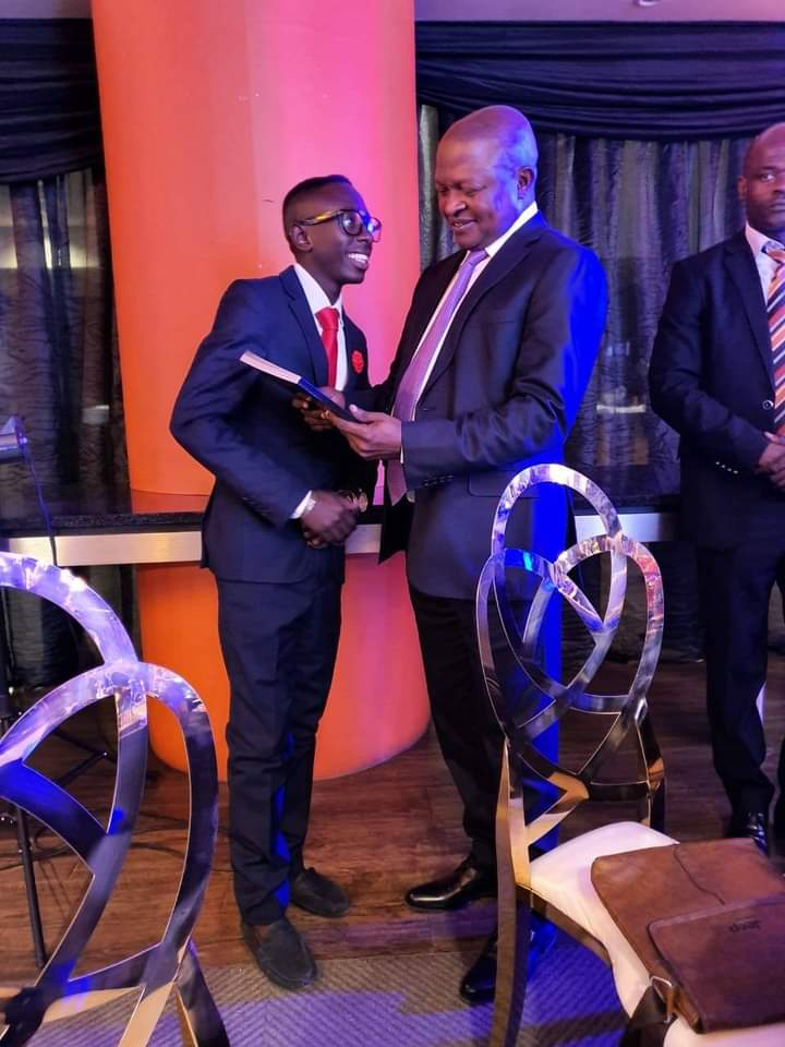 """Author Ronny  (the mind of the mind) presents the first official copy of """"The Chess Grand-Master"""" to deputy President D.D Mabuza"""